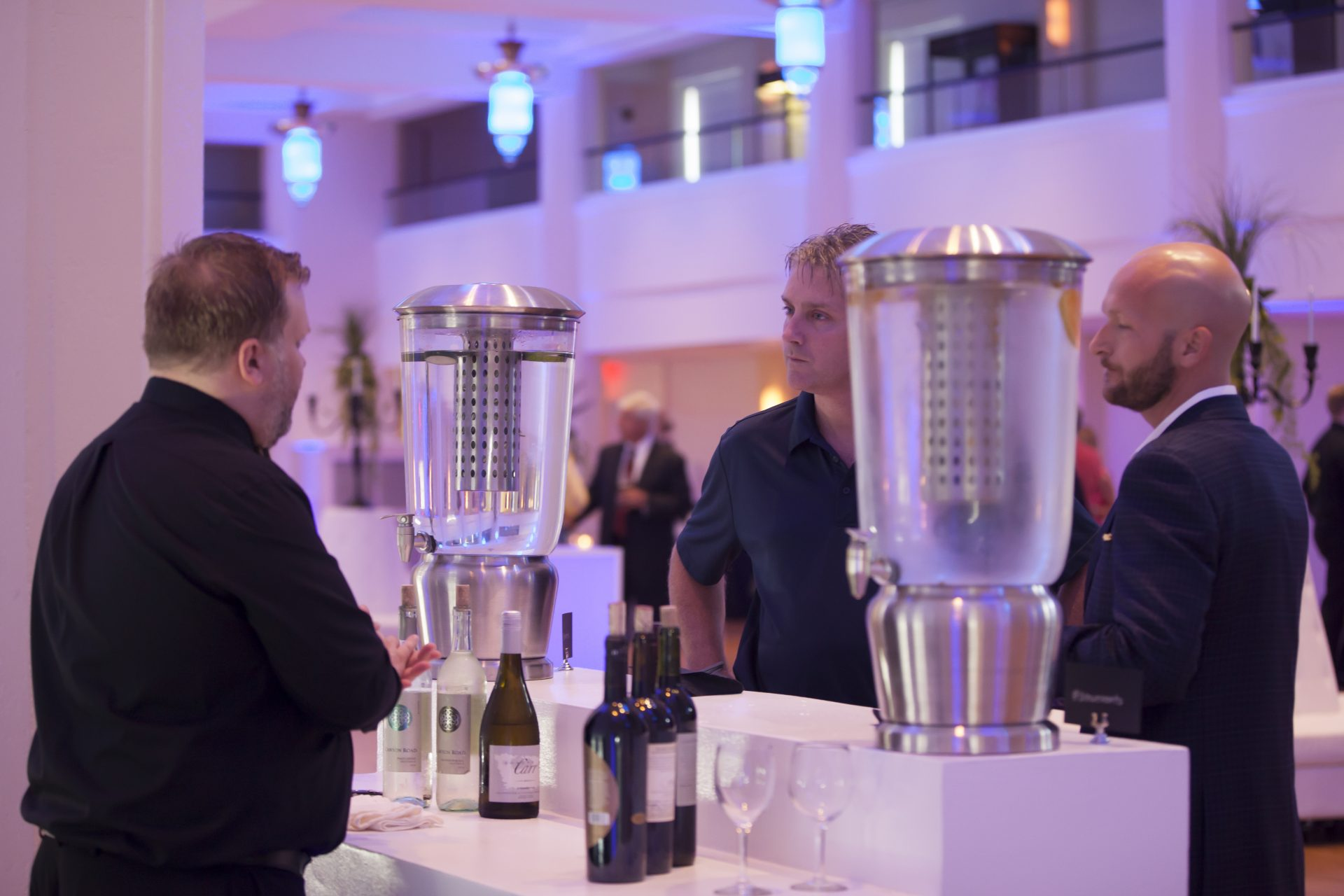 Bleu Events staff members talking by a bar at an event